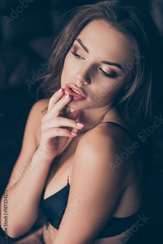 Fototapeta Close up photo of sexy naughty young brunette lady, in seductive nice silk bra, waiting for her lover, touching her lips, so hot, gorgeous and seductive, tempting and provocating obraz