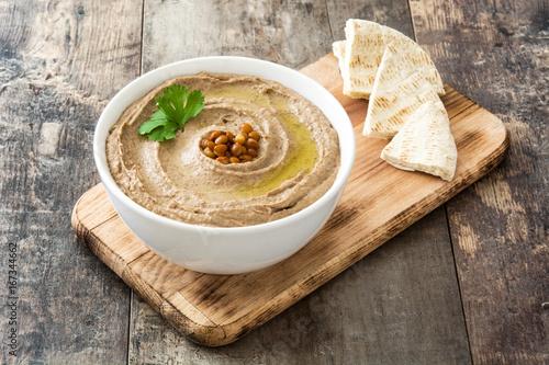 Lentil hummus and pita bread on wood