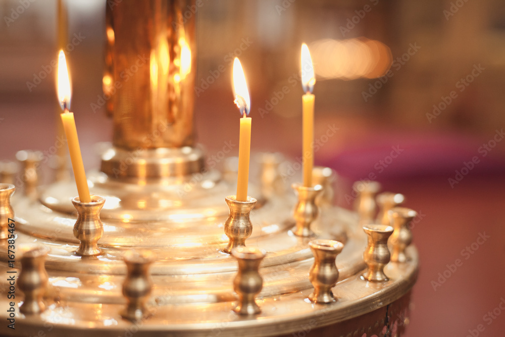 Fototapety, obrazy: Candles and lamp close-up. Interior Of Orthodox Church In Easter. baby christening. Ceremony a in Christian . bathing the into the baptismal font