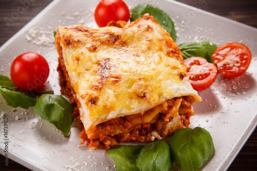 Lasagna on wooden background