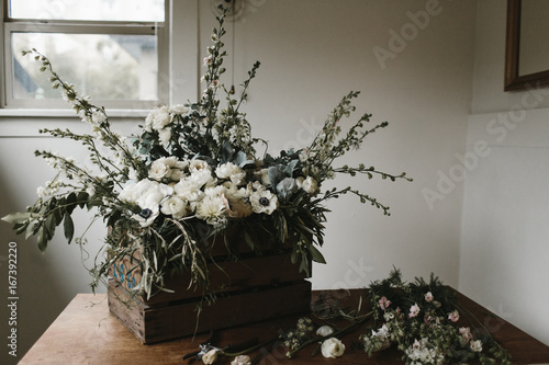 Flowers and greenery in wooden crate