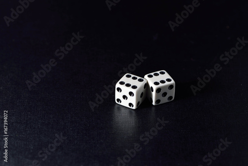 Платно  Two white dice  on black