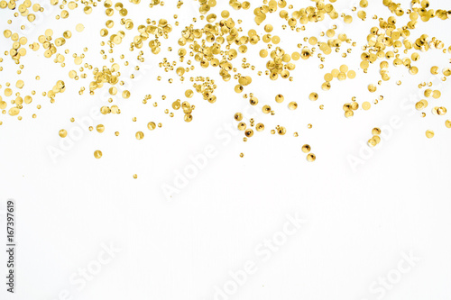 Obraz Golden confetti tinsel on white background. Flat lay, top view. Minimal background. - fototapety do salonu