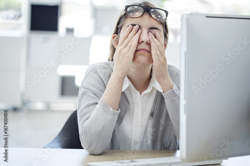 Tired woman touching her eyes Poster