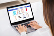 Businesswoman Shopping On Laptop