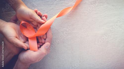 Adult and child hands holding orange Ribbons,  Leukemia cancer awareness and Mul Billede på lærred