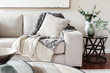 Leinwanddruck Bild - Textured layers interior styling of cushion sofa and throw in nuetral colors