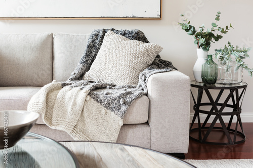 Fotomural Textured layers interior styling of cushion sofa and throw in nuetral colors