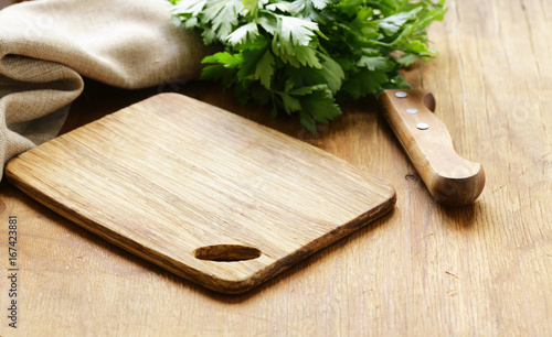 Fotografía Food background, wooden cutting board and knife