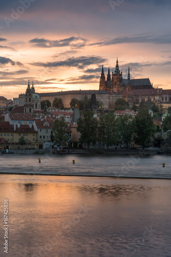 Vertical Prague Castle with cloudy sunset and Charles Bridge. Canvas Print