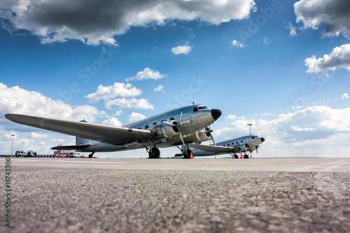 Photo Retro passenger planes at the airport apron