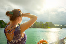Woman Traveler On The Boat, Enjoying View Of The Island At Sunset