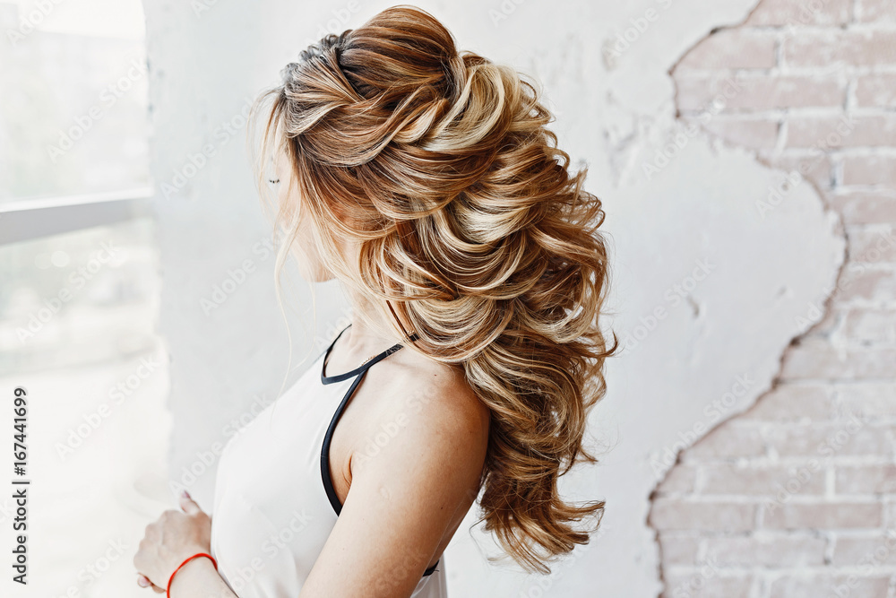 Fototapeta female hairdress for the event, unrecognizable back view