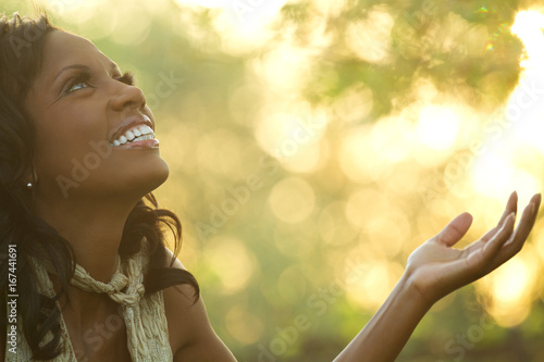 Fotografie, Obraz  Excited African American woman with open arms.