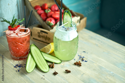 Valokuva  Homemade cucumber and mint lemonade in a glass on a blue wooden background