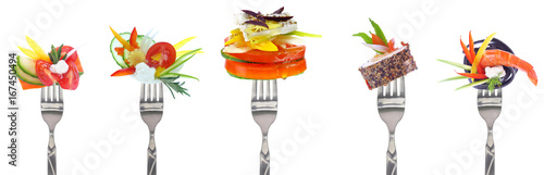 Staande foto Verse groenten Variety of vegetables and cheeses on forks - white background