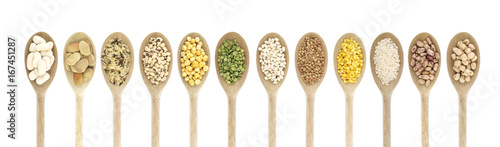 Fotografie, Obraz  Variety of raw legumes and rices in spoons - white background