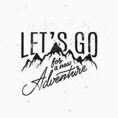 FototapetaVintage Style Hand Lettering. Motivational Quote with mountains Let's Go For A New Adventure. Template for your label, postcard, print, sticker, emblem, camp, apparel, sign, business or art works.