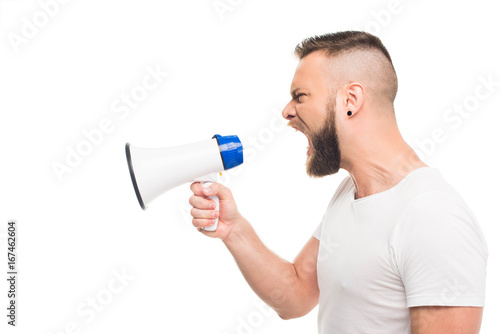 'Portrait og young aggressive man using megaphone, isolated on white Canvas Print