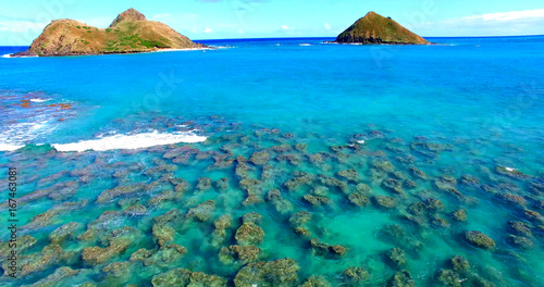 Small Reef in Turquoise Blue Coastal Waters with Two Small Islands - Oahu, Hawaii