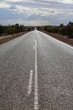 Long straight asphalt road in Western Australia