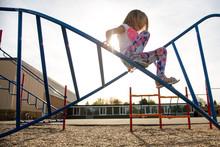 Child On Climbing Frame In Playground