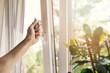 Leinwandbild Motiv hand open white plastic pvc window at home