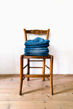 Folded Jeans On Wooden Chair
