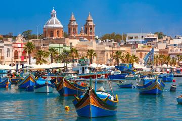 Fototapeta Traditional eyed colorful boats Luzzu in the Harbor of Mediterranean fishing village Marsaxlokk, Malta