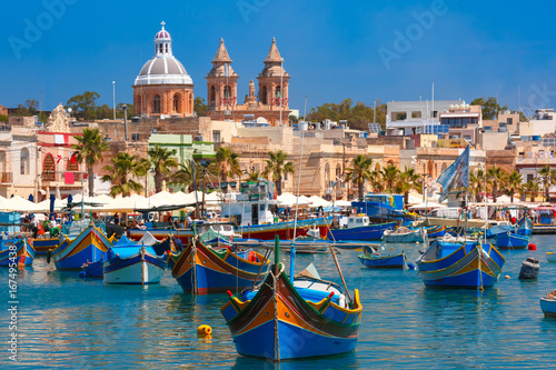 obraz lub plakat Traditional eyed colorful boats Luzzu in the Harbor of Mediterranean fishing village Marsaxlokk, Malta