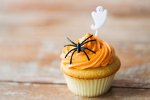 Cupcake With Halloween Decoration On Table