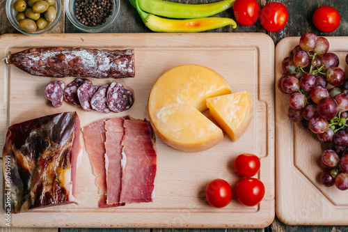 Delicious appetizer on wooden table Poster