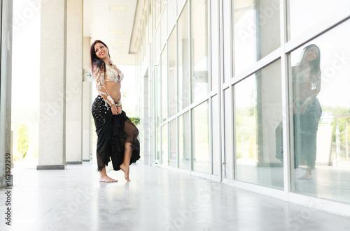Arab woman dancing in big hallway Wallpaper Mural