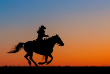 Sillouette Of A Cowgirl On Hor...
