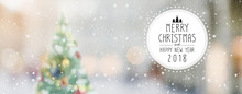 Christmas And Happy New Year 2018 On Blurred Bokeh Christmas Tree With Snowfall Banner Background