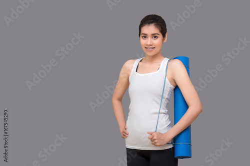Young asian woman holding her yoga mat at healthy sport gym Wallpaper Mural