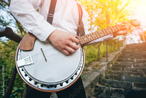 View of musician playing banjo at the street Canvas Print