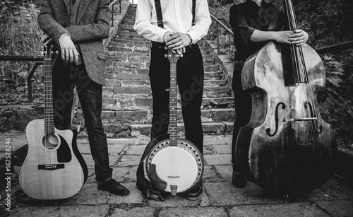 Photo  Trio of musicians with a guitar, banjo and contrabass