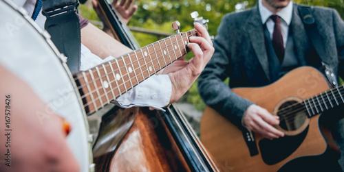 Fotografija  Trio of musicians with a guitar, banjo and contrabass
