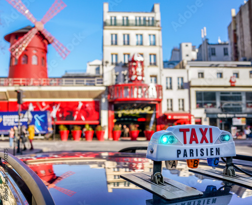 Parisian Taxi sign over blurred Paris boulevard. Canvas Print