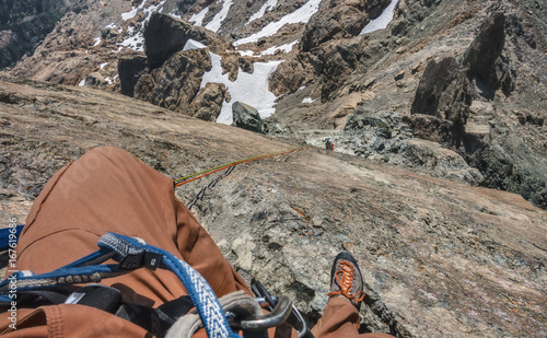 Foto op Plexiglas Alpinisme Rock Climber Rappels in Mountainous Terrain in Washington State
