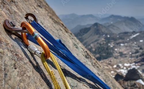 Deurstickers Alpinisme Rock Climbing Anchor and Bolts with Mountain Vista