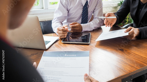 Photo  Business men and resume paper for a job interview concept on meeting table in of