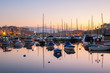 Dawn view of sail boats and yachts in small harbor. Malta.