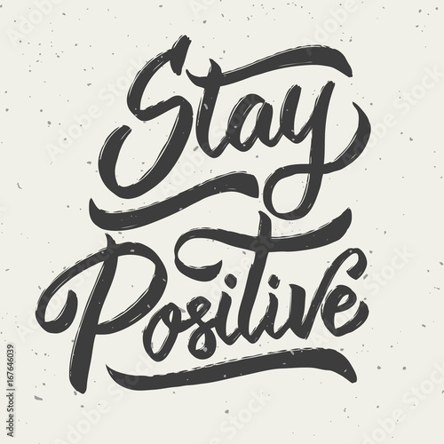 Stay positive. Hand drawn lettering phrase isolated on white background.