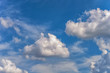 background of a blue sky with a white clouds
