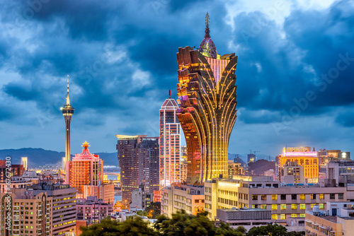 Photo Stands Asian Famous Place Macau, China city skyline at dusk.