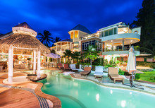Luxury Resort With Swimming Pool And Restaurant At Twiligh
