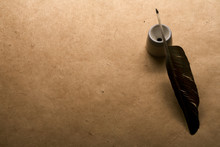Quill Pen In Inkwell On Antiqu...