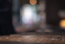 Vintage Wooden Table With Blur Bokeh Background On Cafe